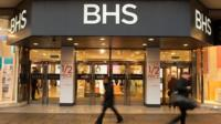 People walking in front of a BHS store