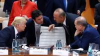 AMBURG, GERMANY - JULY 07: President of Turkey Recep Tayyip Erdogan (R) talks with US President Donald Trump (L), accompanied by Foreign Affairs Minister of Turkey Mevlut Cavusoglu (2nd R), during a session within the G20 Leaders' Summit in Hamburg, Germany on July 07, 2017. (Photo by Kayhan Ozer/Anadolu Agency/Getty Images)
