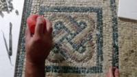 An archaeologist restoring a Roman artefact