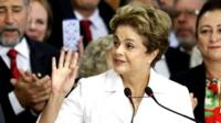 Dilma Rousseff speaks to supporters at the Planalto presidential palace