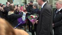 Theresa May fist bumping