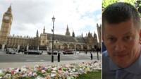 Flowers left outside the Houses of Parliament in honour of PC Keith Palmer and picture of PC Keith Plamer