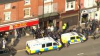 Police and media at the raided flat on Hagley Road
