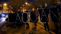 Demonstrators hold signs bearing the name of Laquan McDonald during protests in Chicago, Illinois November 24, 2015