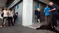 People queue at Greek bank ATM in Athens