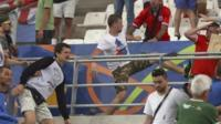Man in Russia shirt kicks another man in Marseille stadium, 11 June 2016