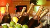 Bowl of champagne bottles