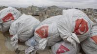 Sandbags bearing Turkish flags on a rooftop in Azaz, northern Syria