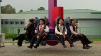 North Koreans on a ride at a funfair