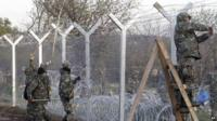 Soldiers erecting border fence