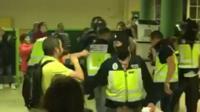 Balaclava-clad police officers