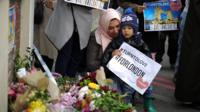 Mum and child laying flowers at scene of terror attack