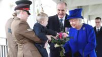 The Queen being given a bouquet by two-year-old Alfie Lunn