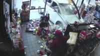 car smashes through shop window