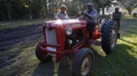 Riding a tractor