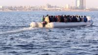 A raft off the coast of Libya carrying migrants trying to reach Europe