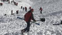 """Search teams work at the site after an avalanche went down at the """"Jochgrubenkopf"""" mountain in the Austrian Alps (15 March)"""