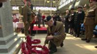 Man laying a wreath at a war memorial