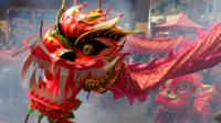 Chinese New Year is on 28 January. People celebrate with fireworks, giving gifts of money in red envelopes, eating special food and performing a lion dance.