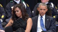 US President Barack Obama and First Lady Michelle Obama attend an interfaith memorial service for the victims of the Dallas police shooting