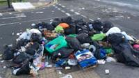 Piles of rubbish in road