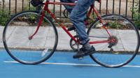 A file photo of a person cycling