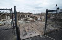 Burned out building behind gate in Fort McMurray