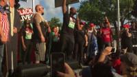 Black Lives Matter activist speaking at Trump rally.