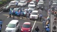 Protestors in Jakarta attacking a cab for not also protesting