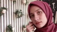 A hijabi fashion influencer