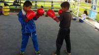 Two young boys practice boxing at a Manipur training camp