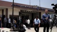 Journalists gather in front of the Egypt Air In flight services building