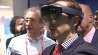 Ken Skates trying virtual reality technology on Deeside
