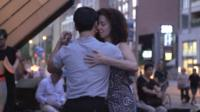 A couple tangos on a Toronto sidewalk