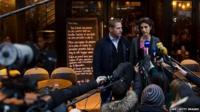 """Audrey Bily (R) and Romain Debray, managers of the bar """"A la Bonne Biere"""", deliver a press conference in front of the cafe in Paris on December 4, 2015"""