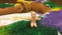 Plastic baby on a king cake