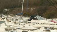 Damaged boats and debris