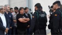 Police and locals in Sant Joan de Vilatorrada