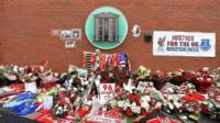 Floral tributes left outside Anfield Stadium