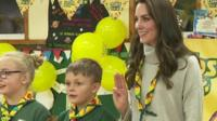 Kate Middleton takes her cub scout promise at a party to celebrate a century of the youth movement.