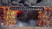 Fire engulfs a rail trestle bridge in Mayerthorpe, Canada