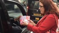 Books handed to taxi drivers