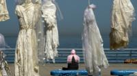wedding dresses hang in Beirut seafront