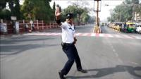 Traffic cop Ranjeet Singh uses moonwalking and dance moves to manage traffic in Indore, India.