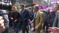 Luke Holland (left) and Nigel Farage (right)