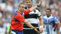 Referee John Lacey issues instructions in a Rugby World Cup warm-up match