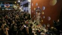 Crowds of fans gathered in tribute to Bowie at a mural in his birthplace of Brixton, south London painted by street artist James Cochran, aka Jimmy C