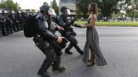 Protester confronts police officers