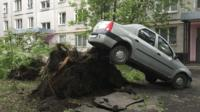 A car lifted by the roots of a tree which was toppled during a heavy storm, in Moscow. 29 May 2017