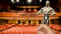 A graphic of person holding an award